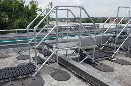 Stepover platforms for roof maintenance access