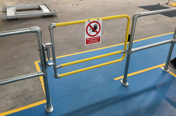 Industrial safety gate for restricted access areas