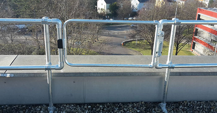 Safety gate as part of a KeeGuard roof handrail system