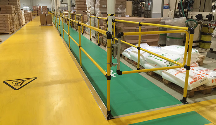 Yellow safety gate for a warehouse walkway