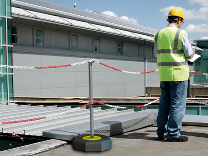 demarcation barrier system in use on a roof