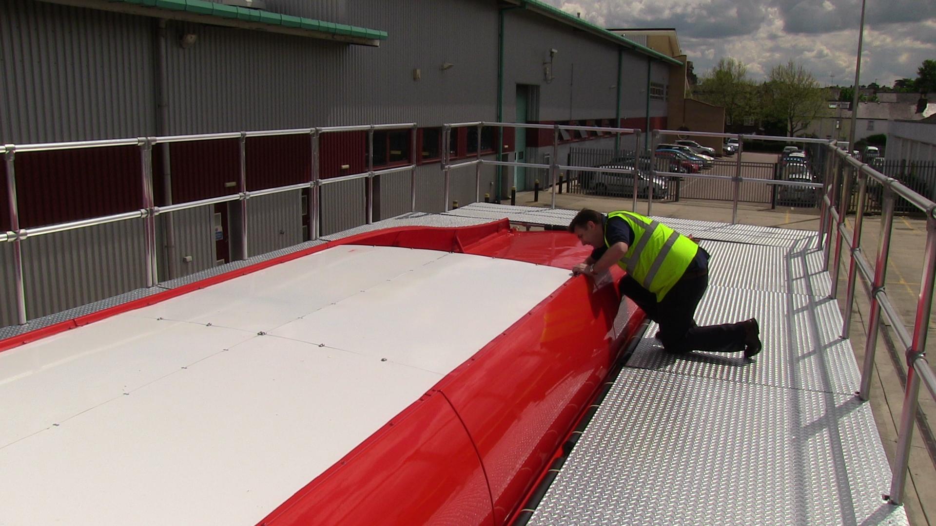 maintenance engineer using a bespoke platform for buses
